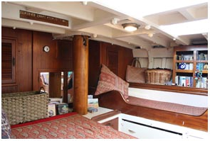 aft cabin with a double and single berth