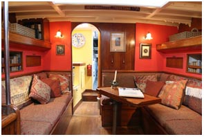 comfortable saloon easily sits eight and also contains two upper bunks and two settee berths